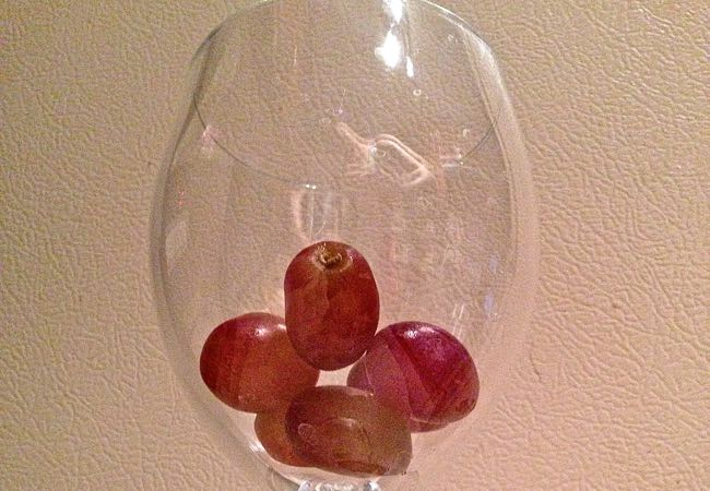 Use frozen grapes to chill your wine/keep your wine cold