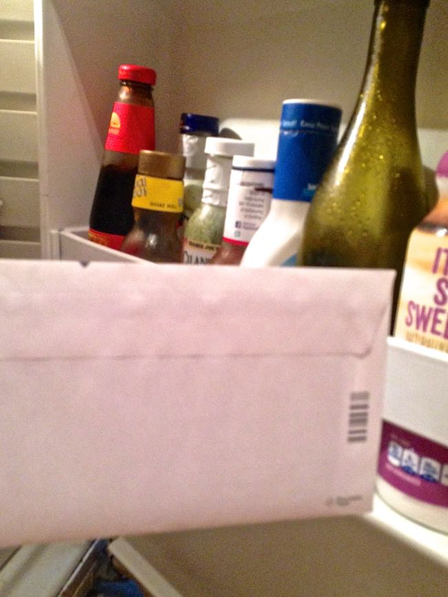 Put an envelope in the fridge to re-open easily